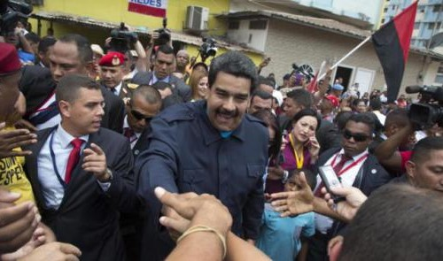 "Venezuela's President Nicolas Maduro, greets supporters before a commemorative ceremony at the monument for the 500-plus victims of the 1989 US invasion of Panama in the neighborhood of Chorrillo in Panama City, Friday, April 10, 2015.   Shortly after arriving Friday,Maduro visited a monument honoring victims of the 1989 U.S. invasion of Panama. A crowd of several hundred chanted in Spanish, ""Maduro, stick it to the Yankee!""(AP Photo/Ramon Espinosa)"